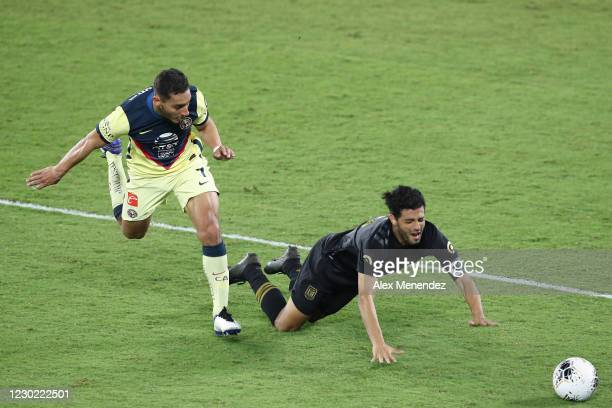 Sebastian Caceres of Club America fouls Carlos Vela of Los Angeles FC during the CONCACAF Champions League semifinal game at Exploria Stadium on...