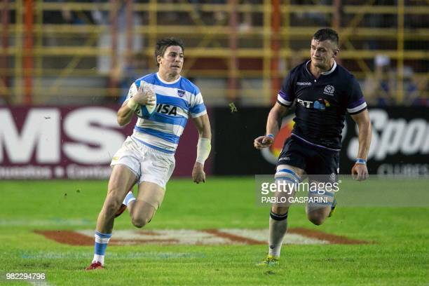 Sebastian Cancelliere from Argentina runs with the ball during their international test match against Scotland at the Centenario stadium in...