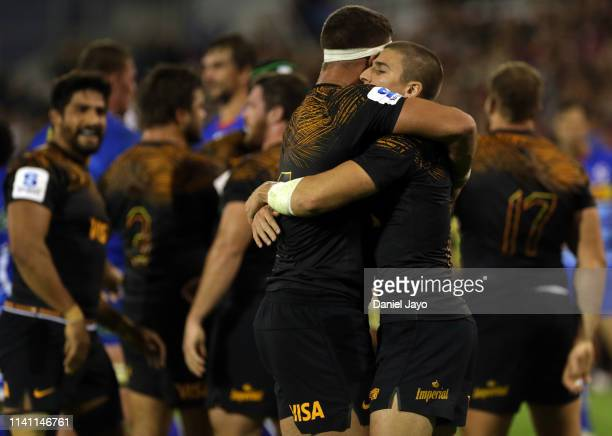 Sebastian Cancelliere of Jaguares hugs teammate Marcos Kremer as their celebrate defeating Stormers after a match between Jaguares and Stormers as...