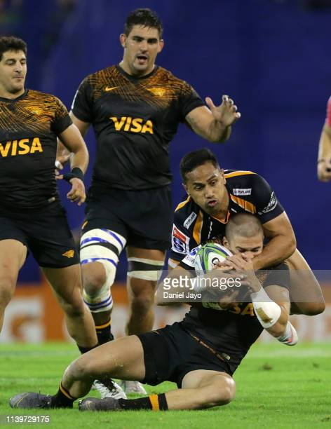 Sebastian Cancelliere of Jaguares is tackled by Toni Pulu of Brumbies during a Super Rugby Rd 11 match between Jaguares and Brumbies at Jose...