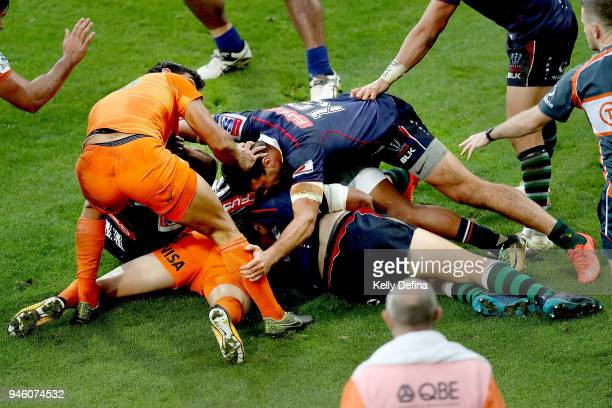 Sebastian Cancelliere of the Jaguares is tackled by Rebels defence during the round nine Super Rugby match between the Rebels and the Jaguares at...