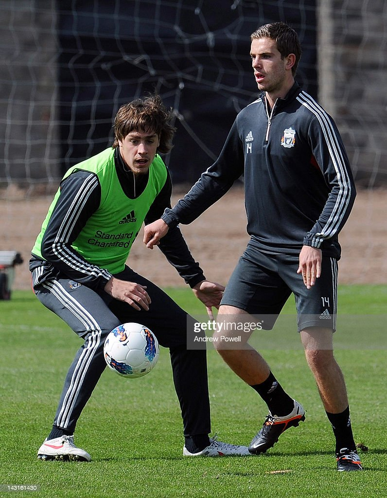 Sebastian Coates (L) and Jordan Henderson of Liverpool in action during a training session at Melwood Training Ground on April 20, 2012 in Liverpool, England.