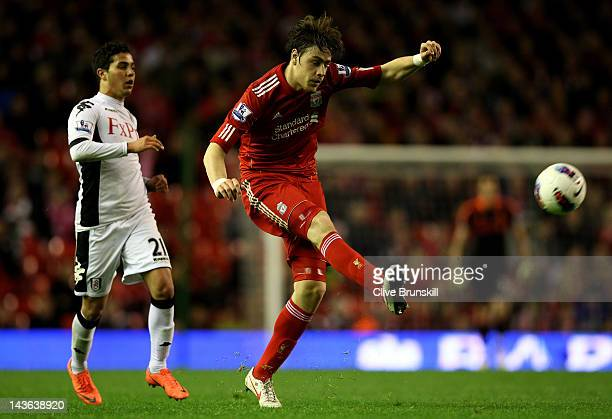 Sebastian Coates of Liverpool competes with Kerim Frei of Fulham during the Barclays Premier League match between Liverpool and Fulham at Anfield on...
