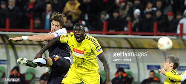 Sebastian Coates of Liverpool goes up with Christopher Samba of FC Anzhi Makhachkala during the UEFA Europa League match between FC Anzhi Makhachkala...