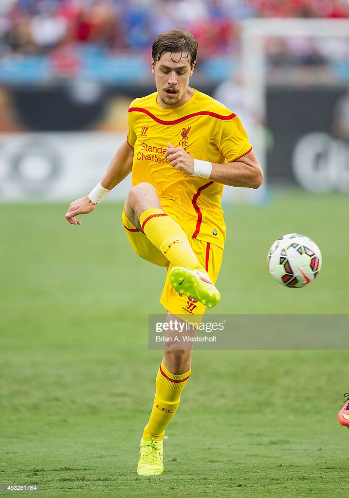Sebastian Coates #16 of Liverpool passes the ball during first half action against A.C. Milan in the Guinness International Champions Cup at Bank of America Stadium on August 2, 2014 in Charlotte, North Carolina. Liverpool defeated A.C. Milan 2-0.