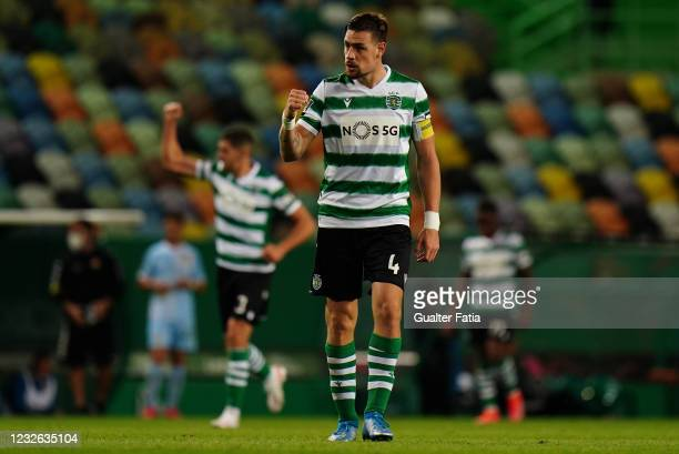 Sebastian Coates of Sporting CP celebrates after teammate Zouhair Feddal of Sporting CP scored a goal during the Liga NOS match between Sporting CP...