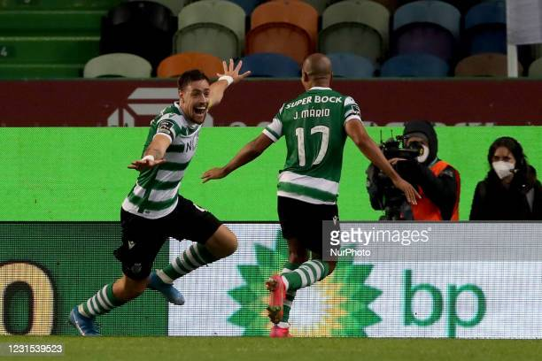 Sebastian Coates of Sporting CP celebrates with Joao Mario after scoring a goal during the Portuguese League football match between Sporting CP and...