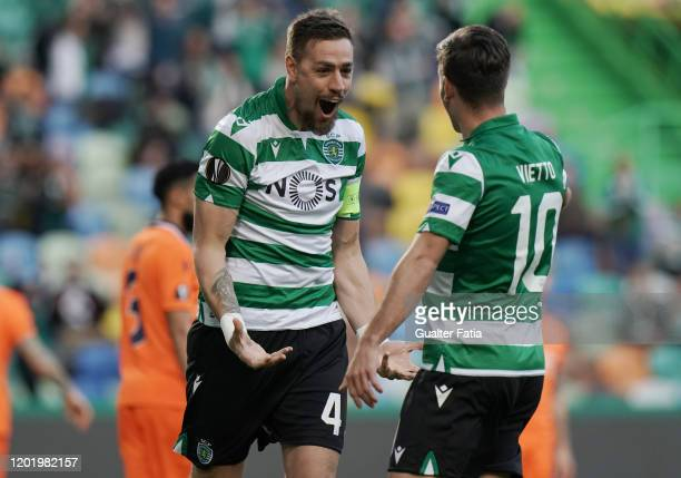 Sebastian Coates of Sporting CP celebrates with teammate Luciano Vietto of Sporting CP after scoring a goal during the UEFA Europa League Round of 32...