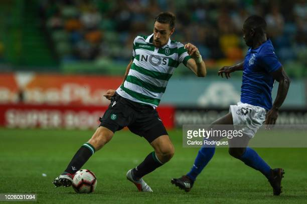 Sebastian Coates of Sporting CP vies with Kodjo Alphonse of CD Feirense for the ball possession during the Liga NOS match between Sporting CP and CD...