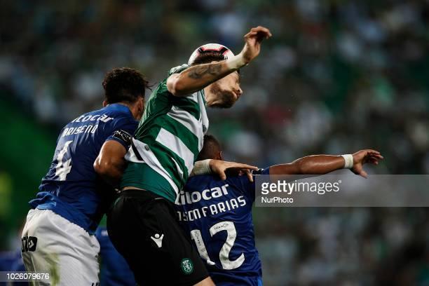 Sebastian Coates of Sporting heads for the ball with Antonio Briseno of Feirense and Edson Farias of Feirense during Primeira Liga 2018/19 match...