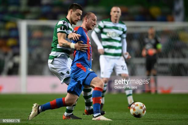 Sebastian Coates of Sporting Lisbon competes for the ball with Michal Krmencik of Viktoria Plzen during the UEFA Europa League Round of 16 first leg...