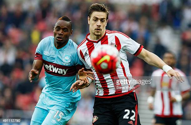 Sebastian Coates of Sunderland and Diafra Sakho of West Ham United compete for the ball during the Barclays Premier League match between Sunderland...