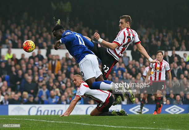 Sebastian Coates of Sunderland scores an own goal for their third goal as Romelu Lukaku of Everton attempts to reach the ball during the Barclays...