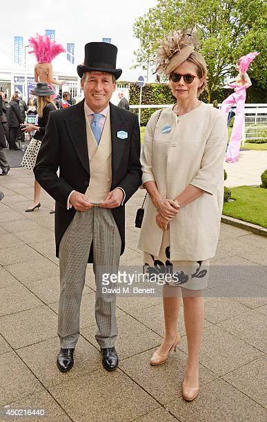 Sebastian Coe and Carole Annett attend Derby Day at the Investec Derby Festival at Epsom Downs Racecourse on June 6 2014 in Epsom England
