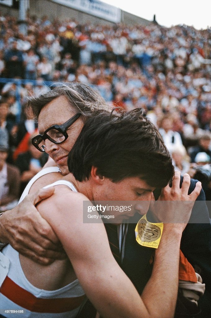 Sebastian Coe is embraced by his father, Peter Coe, after running a world record 3:48.95 in the IAAF Dubai Golden Mile at Bislett Stadium on July 17, 1979 in Oslo, Norway.