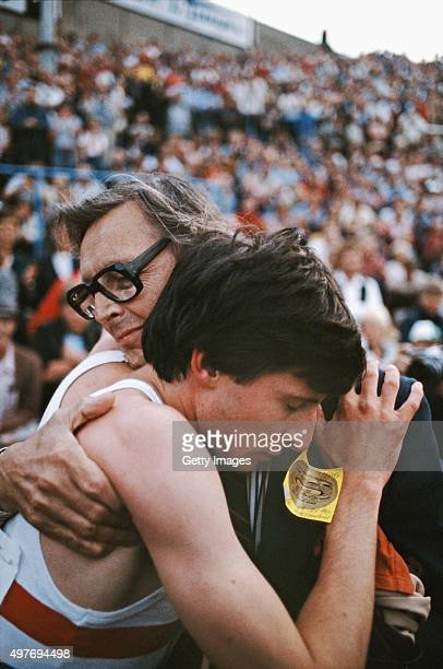 Sebastian Coe is embraced by his father Peter Coe after running a world record 34895 in the IAAF Dubai Golden Mile at Bislett Stadium on July 17 1979...