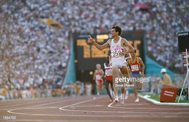 Sebastian Coe of Great Britain gestures to the crowd and media as he crosses the finishing line to win the gold medal with an Olympic record time of...