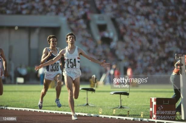 Sebastian Coe of Great Britain raises his arms in celebration as he crosses the finish line to win the men's 1500m race at the 1980 Summer Olympic...