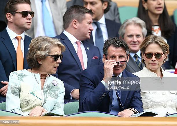 Sebastian Coe sits in the Royal box on centre court to watch Japan's Kei Nishikori and France's Julien Benneteau during their men's singles second...