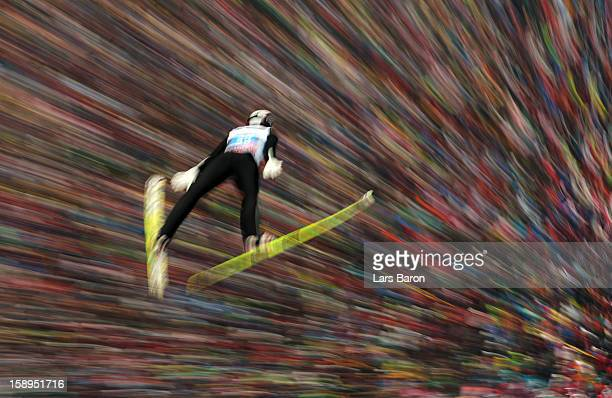 Sebastian Colloredo of Italy competes during the first round for the FIS Ski Jumping World Cup event of the 61st Four Hills ski jumping tournament at...