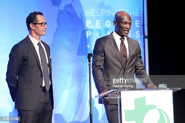 Sebastian Copeland and actor Peter Mensah speak onstage during the Global Green USA 19th Annual Millennium Awards on June 6 2015 in Century City...