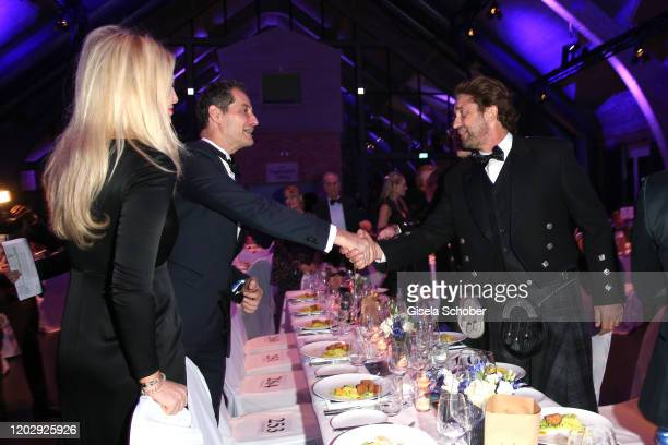 Sebastian Copeland and his wife Dr Carolin Copeland and Gerard Butler during the Cinema For Peace Gala at Westhafen Event Convention Center on...