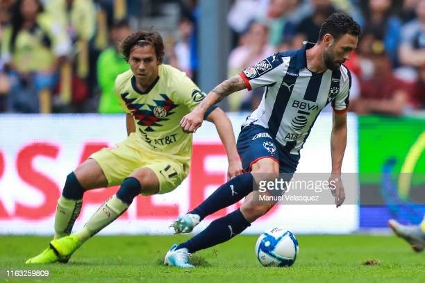 Sebastian Cordoba of America struggles for the ball against Miguel Layun of Monterrey during the 1st round match between America and Monterrey as...