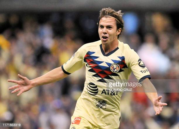 Sebastian Cordova of America celebrates after scoring a goal during the Mexican Apertura tournament football match between Club America and...