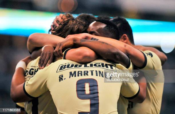 Sebastian Cordova of America celebrates with teammates after scoring a goal during the Mexican Apertura tournament football match between Club...