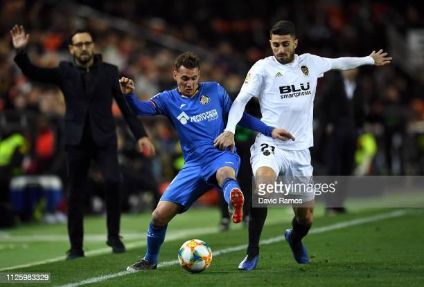 Sebastian Cristoforo of Getafe battles for the ball with Cristiano Piccini of Valencia during the Copa del Rey Quarter Final match between Valencia...