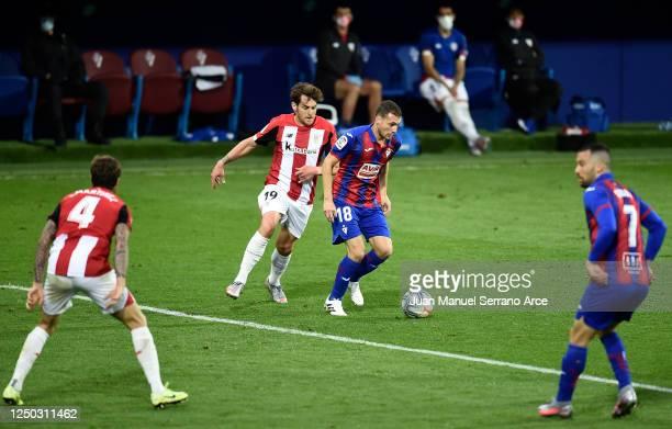 Sebastian Cristoforo of SD Eibar battles for possession with Ibai Gomez of Athletic Club during the La Liga match between SD Eibar SAD and Athletic...