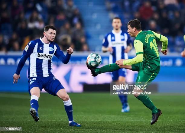 Sebastian Cristoforo of SD Eibar duels for the ball with al2 of Alaves during the Liga match between Deportivo Alaves and SD Eibar SAD at Estadio de...