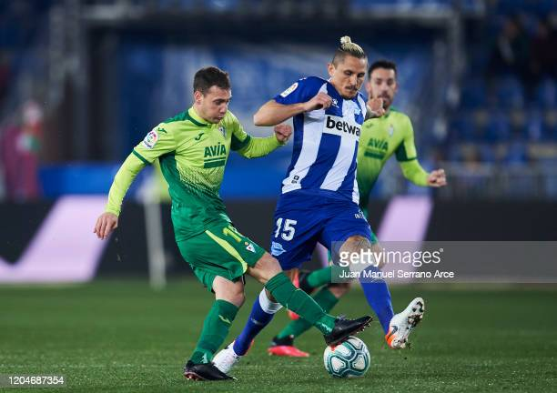 Sebastian Cristoforo of SD Eibar duels for the ball with Ljubomir Fejsa of Alaves during the Liga match between Deportivo Alaves and SD Eibar SAD at...