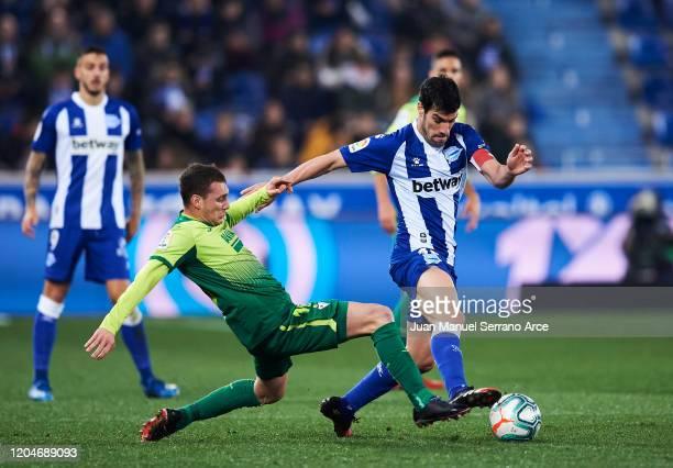 Sebastian Cristoforo of SD Eibar duels for the ball with Manuel Garcia of Alaves during the Liga match between Deportivo Alaves and SD Eibar SAD at...