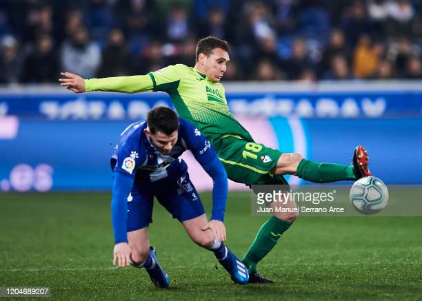 Sebastian Cristoforo of SD Eibar duels for the ball with Oliver Burke of Alaves during the Liga match between Deportivo Alaves and SD Eibar SAD at...