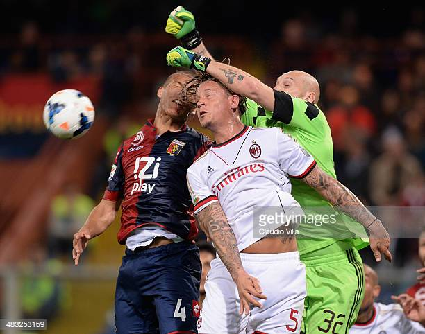Sebastian De Maio of Genoa CFC Philippe Mexes and Christian Abbiati of AC Milan compete for the ball during the Serie A match between Genoa CFC v AC...