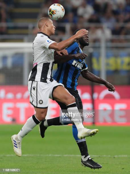 Sebastian De Maio of Udinese Calcio jumps for the ball against Romelu Lukaku of FC Internazionale during the Serie A match between FC Internazionale...