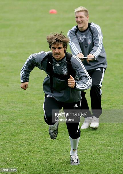 Sebastian Deisler and Bastian Schweinsteiger in action during the German National Team training for the FIFA Confederations Cup on June 13 2005 in...