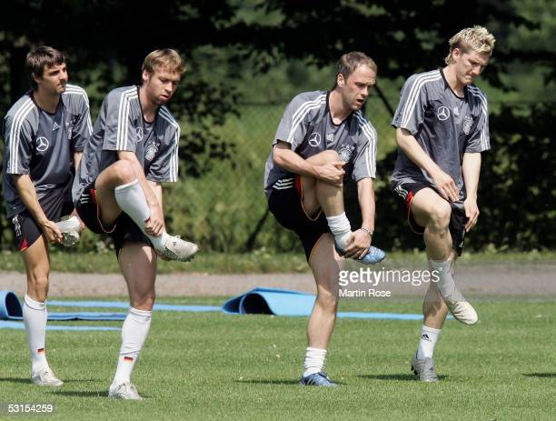 Sebastian Deisler Andreas Hinkel Fabian Ernst and Bastian Schweinsteiger of Germany seen in action during the training session of the German National...