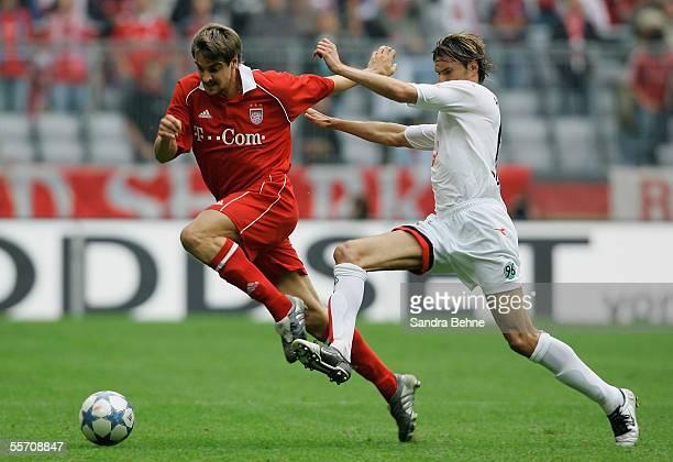Sebastian Deisler of Bayern Munich challenges Thomas Brdaric of Hanover 96 during the Bundesliga match between Bayern Munich and Hanover 96 at the...