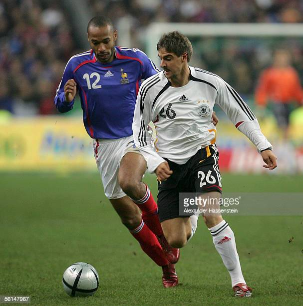 Sebastian Deisler of Germany challenges Thierry Henry of France for the ball during the international friendly match between France and Germany at...