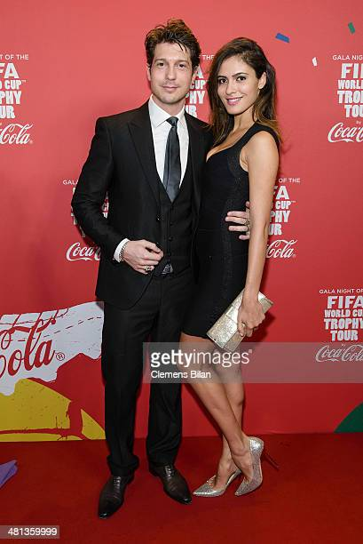 Sebastian Deyle und Tatiana Silva attend the Gala Night of the FIFA World Cup Trophy Tour on March 29 2014 in Berlin Germany