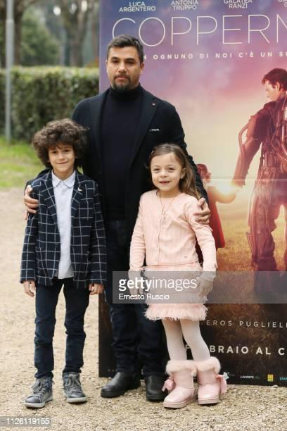 Sebastian Dimulescu Eros Puglielli and Angelica Bellucci attend 'Copperman' photocall at Casa del Cinema on January 30 2019 in Rome Italy
