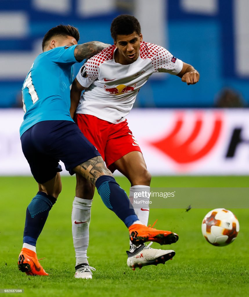 Sebastian Driussi (L) of FC Zenit Saint Petersburg and Bernardo of RB Leipzig vie for the ball during the UEFA Europa League Round of 16 second leg match between FC Zenit St. Petersburg and RB Leipzig at Saint Petersburg Stadium on March 15, 2018 in Saint Petersburg, Russia.