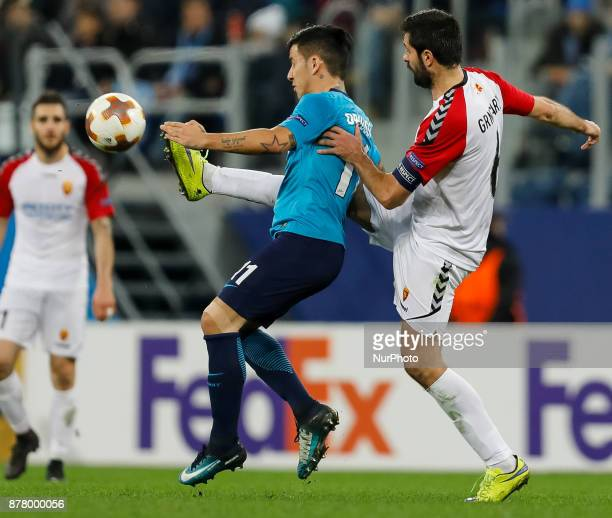 Sebastian Driussi of FC Zenit Saint Petersburg and Boban Grncharov of FK Vardar vie for the ball during the UEFA Europa League Group L match between...