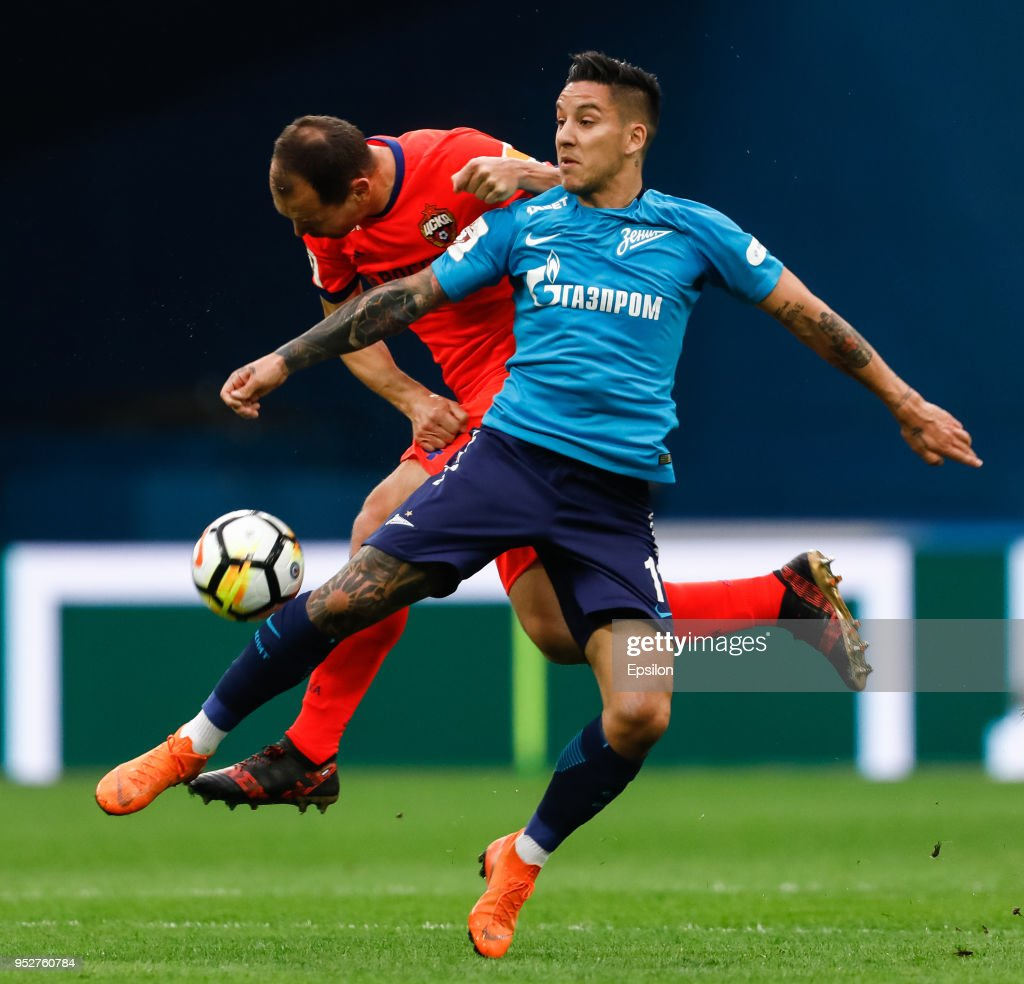 Sebastian Driussi (R) of FC Zenit Saint Petersburg and Sergei Ignashevich of PFC CSKA Moscow vie for the ball during the Russian Football League match between FC Zenit Saint Petersburg and PFC CSKA Moscow on April 29, 2018 at Saint Petersburg Stadium in Saint Petersburg, Russia.