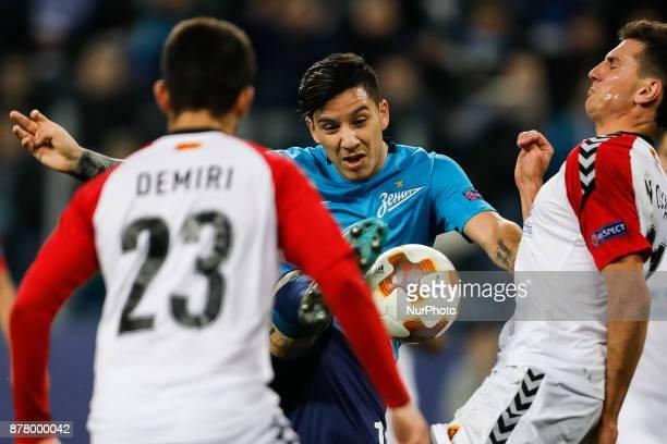 Sebastian Driussi of FC Zenit Saint Petersburg vies for the ball with Besir Demiri and Evgenii Novak of FK Vardar during the UEFA Europa League Group...