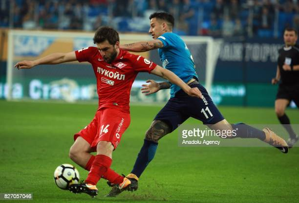 Sebastian Driussi of FC Zenit SaintPetersburg in action against Georgy Dzhikia of FC Spartak Moscow during the Russian Premiere League match between...