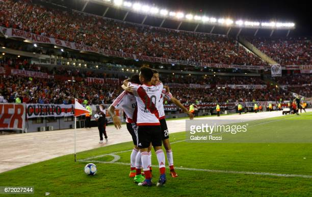 Sebastian Driussi of River Plate celebrates with teammates Gonzalo Martinez and Ignacio Fernandez after scoring the first goal of his team during a...