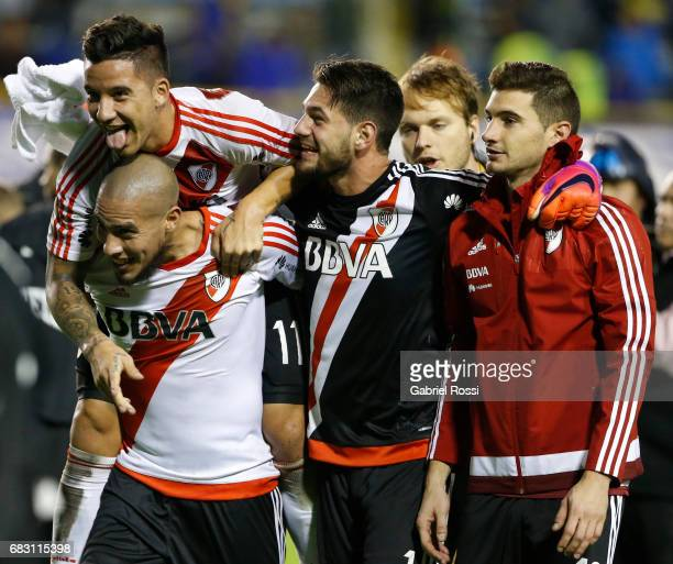 Sebastian Driussi of River Plate celebrates with teammates Jonathan Maidana Augusto Batalla and Lucas Alario after wining a match between Boca...